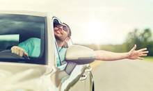 Road Trip, Transport, Travel And People Concept - Happy Smiling Man In Sunglasses Driving Car And Waving Hand