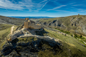 Fototapeta na wymiar El Burgo de Osma medieval castle and town aerial view in Castille and Leon Spain with blue sky on a sunny day