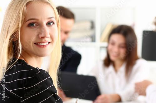 Fototapeta Beautiful smiling cheerful girl at workplace look in camera obraz na płótnie