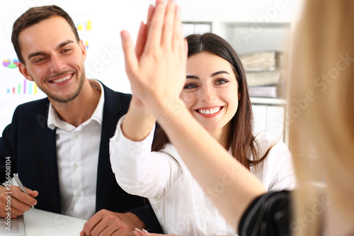 Stampa su Tela  Group of joyful smiling happy people celebrate win