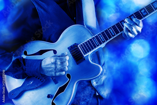 playing jazz guitar on stage - 256419546