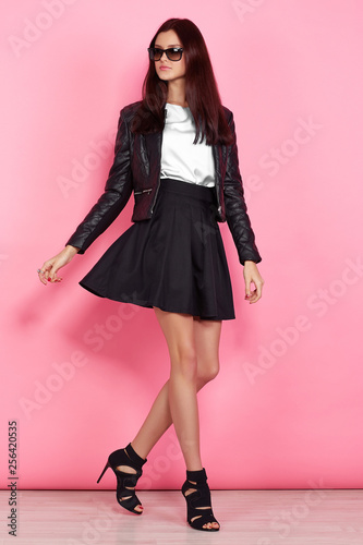 Carta da parati Young fashion woman in black leather jacket and black skirt