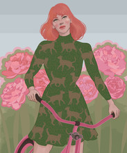 Red-haired Girl In A Dress Riding A Bike Among A Blooming Garden