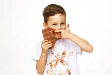 Little Boy With Face And Hands In Chocolate