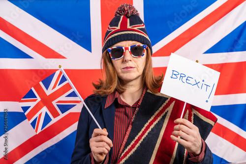 Fényképezés  British woman UK flag and Brexit banner