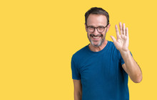 Handsome Middle Age Hoary Senior Man Wearin Glasses Over Isolated Background Waiving Saying Hello Happy And Smiling, Friendly Welcome Gesture