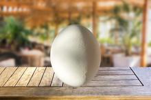 White Egg On Wooden Bar Table ...