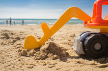 Excavator Toy At The Beach