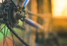Old And Rusty Bicycle Chain And Sprocket, Close Up And Soft Focus
