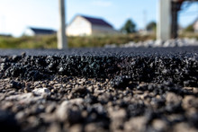 Stones On The Edge Of The Asphalt Road