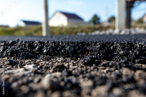 Stones on the edge of the asphalt road Fototapeta