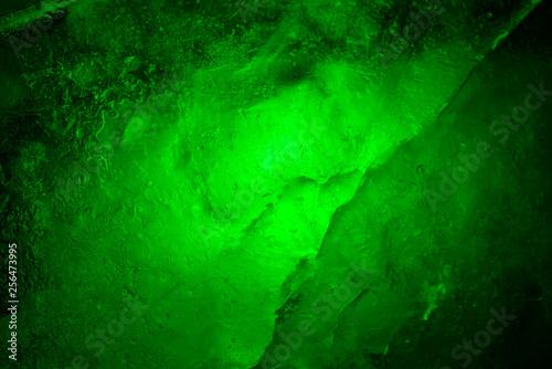 Dark green emerald abstract background. Illuminated and translucent. - 256473995