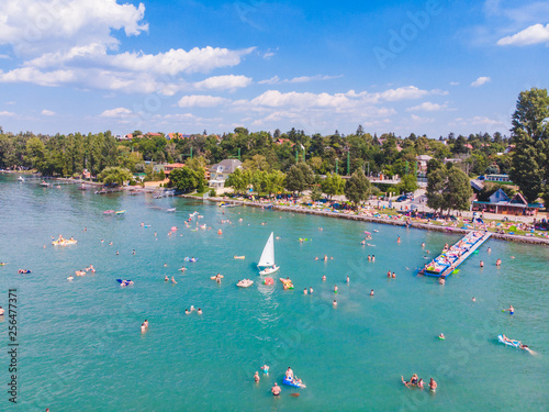 aerial view of lake with swimming people. summer time Wallpaper Mural