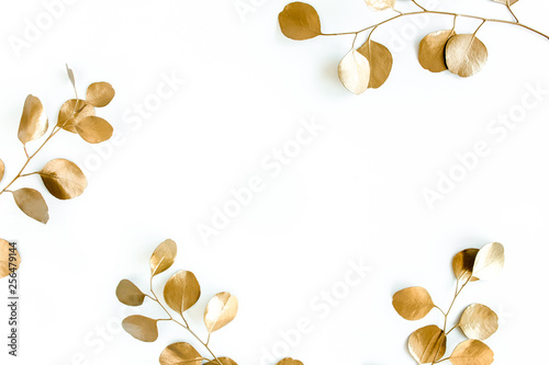 Fotografie, Obraz  Borders of the frame of gold branches, eucalyptus leaves on a white background