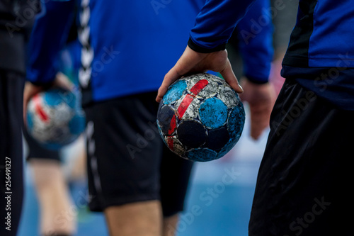 Fototapeta Player holding the ball for handball