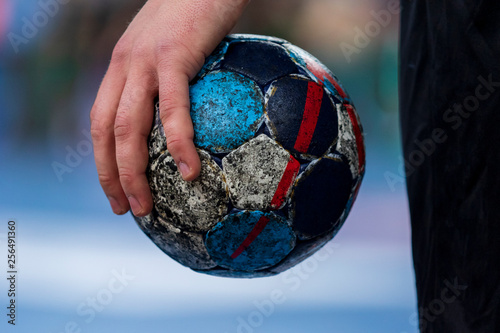 Photo Player holding the ball for handball