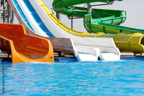 Fotografía  Multicoloured big water slide in the public swimming pool