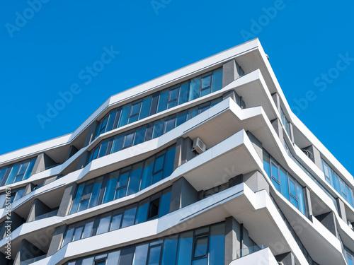 Fototapeta view to white lines of facade of house under blue sky obraz