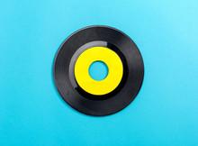 Vintage Retro Vinyl Record On A Blue Paper Background