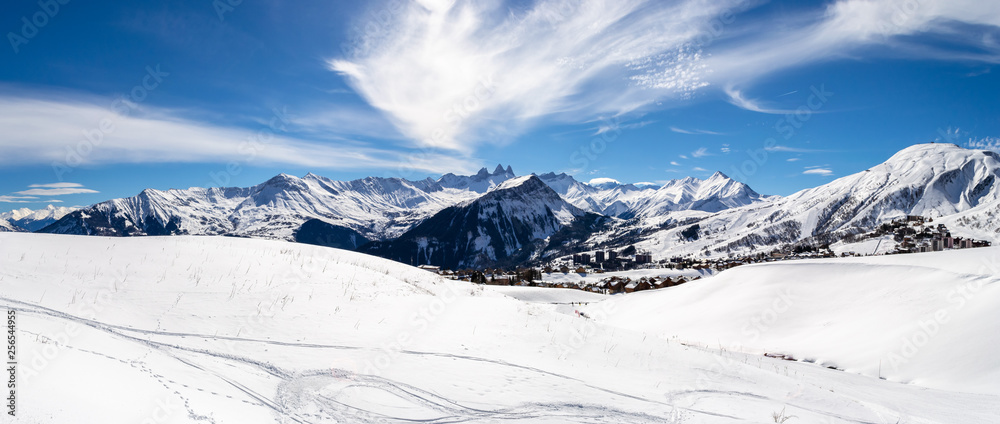 Fototapety, obrazy: Panoramic landscape with mountain peaks in the French Alps, above La Toussuire village, on a sunny Winter day, in Les Sybelles ski area.