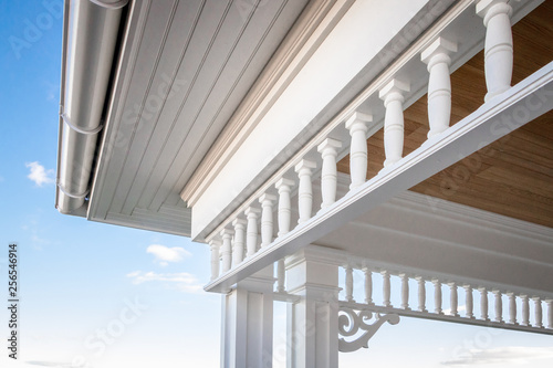 Closeup angled view of PVC millwork, pillars, and woodwork on home residence Canvas Print
