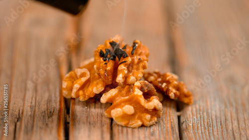 Photo MACRO: Smoke rises from the burnt walnut halves after being roasted by blowtorch