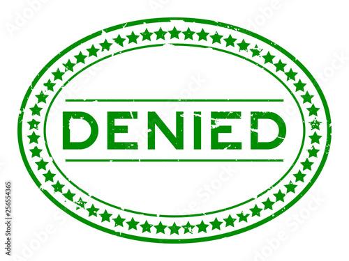 Fotografía  Grunge green denied word oval rubber seal stamp on white background