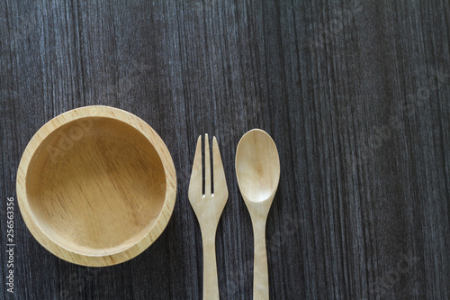 Fotografie, Obraz  Wooden spoon and fork with wooden bowl on wooden table