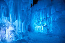 Wall Of Blue Icicles On A Subzero Night After Sunset On A Lake In Minnesota USA