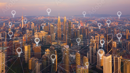 Canvas Prints Kuala Lumpur Map pin flat of city, global business and network connection in futuristic technology concept in Asia. Skyscraper and high-rise buildings at sunset in Kuala Lumpur Downtown, Malaysia.
