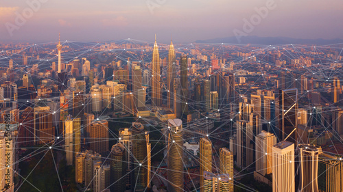 Deurstickers Kuala Lumpur Digital network connection lines of Kuala Lumpur Downtown, Malaysia. Financial district and business centers in smart city in technology concept. Skyscraper and high-rise buildings at sunset
