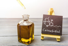 Cbd Oil In Glass Bottle And Ch...