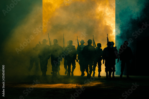 Fotomural  silhouette thai soldiers special forces team full uniform walking action through