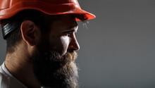 Bearded Man Worker With Beard In Building Helmet Or Hard Hat. Man Builders, Industry. Portrait Architect Builder, Civil Engineer Working. Builder In Hard Hat, Foreman Or Repairman In The Helmet.