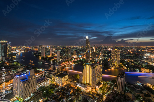 Landscape of Chao phraya river in Bangkok city in evening time with bird view Wallpaper Mural
