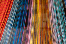 Colored Threads Of An Ancient Wooden Loom