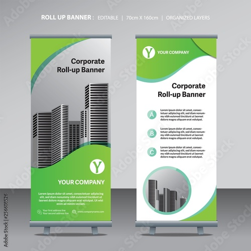 Photo  green color scheme with city background business roll up design template