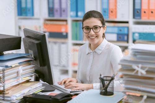 Fényképezés Young secretary working and smiling