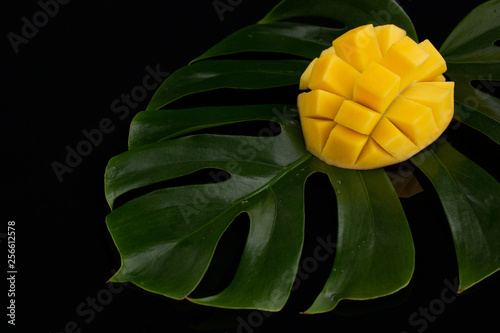 Staande foto Roze Peeled Pineapple on plant leafs over black background