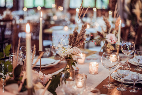 Fototapeta rustic wedding decorations with flowers and candles