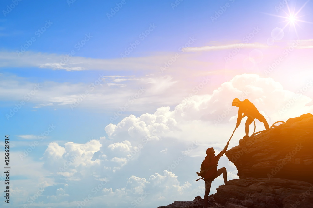 Fototapety, obrazy: Climbing team are on the climb to the cliff,hiking and team work concept.