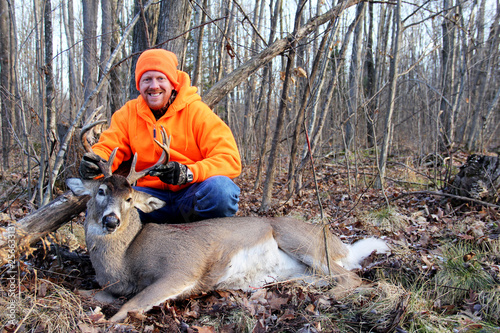 Tablou Canvas Hunter with a Harvested Whitetail Buck
