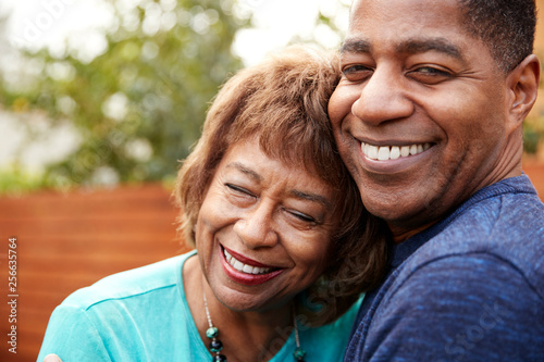 Fototapety, obrazy: Happy senior black woman and her middle aged son embracing, head and shoulders, close up