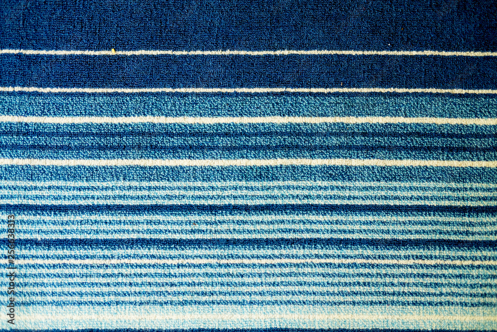 Fototapeta Texture of textile rug with striped pattern of white and blue