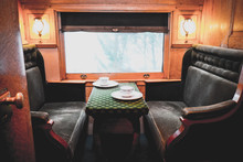 Travelling Inside A Luxurious Vintage Train Carriage, Private Room With Window View. Tea Set Served On Table