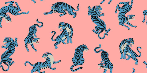 Vector seamless pattern with cute tigers on the pink background. Fashionable fabric design.