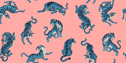 Fototapeten Künstlich Vector seamless pattern with cute tigers on the pink background. Fashionable fabric design.