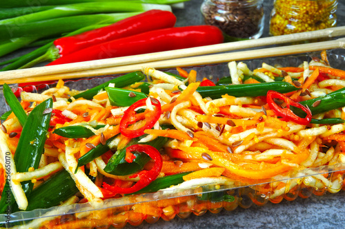 Salad from marinated vegetables with green onions in Chinese style