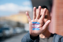 Transgender Flag In The Palm Of The Hand.