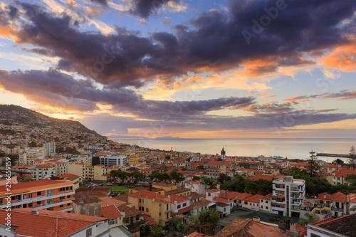 Beautiful skyline cityscape of the city Funchal on the island Madeira at sunrise in summer © dennisvdwater